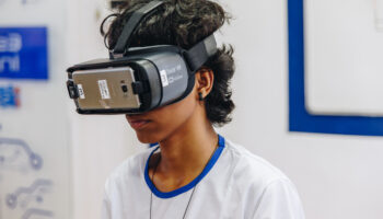 Boy wearing Virtual reality glasses. This is a digital inclusion action from Ramacrisna Institute