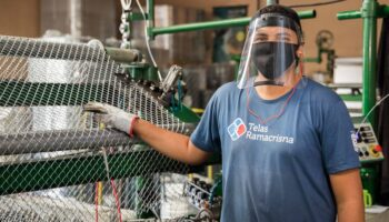 Telas Ramacrisna's worker. He is wearing a mask and a faceshield