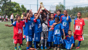 kids holding a trophy. Soccer is a sport for kids at Ramacrisna Institute